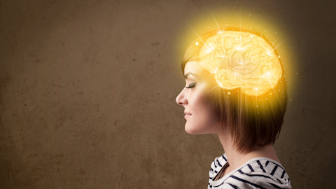 Girl with a glowing brain and grey background