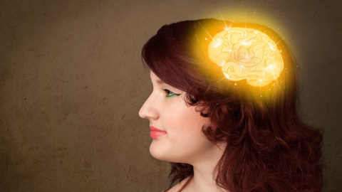 Girl with a glowing brain and grungy background